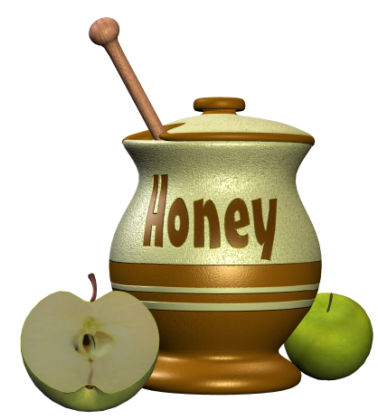 A honey jar and two green apples